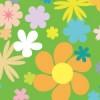 緑背景にたくさんの花が散りばめられたのシームレスパターン