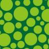 様々なサイズの緑の円が散らばるパターン