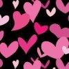 黒い背景にピンクのハートが散らばるパターン