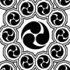 黒い巴紋が幾何学的につながるパターン