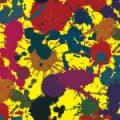黄色背景に様々な濃色系のインクが飛び散るパターン